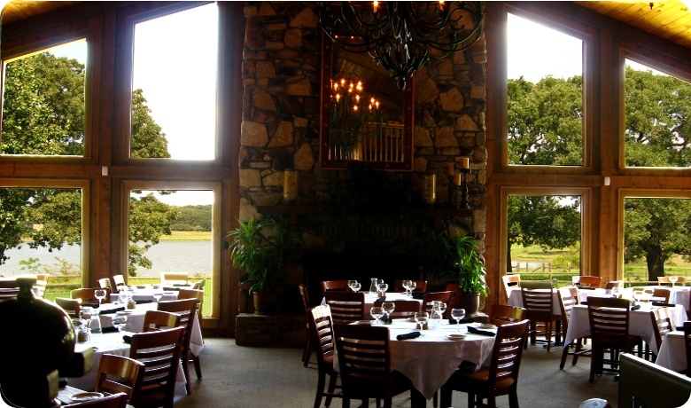 A view of the water and wine from inside of Four Winds Steakhouse.